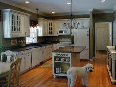 """I'm seriously considering this color for our kitchen redo. :-) On Claudine Barnett's yournestdesignblogspot.com: """"A deep greyish olive green in this kitchen serves as a dramatic, yet neutral backdrop. A neutral is just that - it doesn't dictate a color scheme. It should be able to blend into whatever color scheme or accent color you choose and not be the focal point of your room."""""""
