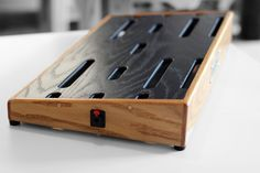 """Here's a GroundSwell Pedalboard. It features summer oak sides/front/back and a jet black oak ply top. This one shipped to Mike- owner of """"Pedal of the day. Diy Pedalboard, Guitar Pedal Board, Heavy Metal Guitar, Guitar Room, Music Production, Guitar Pedals, Mandolin, Playing Guitar, Music Stuff"""