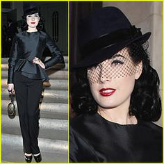 In this YSL outfit, I think Dita Von Tesse gives homage to zoot-suit era. The outfit #re-appropriates the style of both the male and female gangsters of the time.  Her all black get up embellished with fishnet is reminiscent of what the Black Widows were wearing (Cosgrove 84) while its unique structure, its uniform-like quality and the hat all reflect the male zoot-suit. It strikes me that this outfit in no way screams juvenile delinquent, but then again, neither does the zoot-suit in…