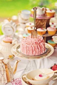 yummy pink cake - I love the way a table full if pretty sweets looks - makes me feel like Alice in wonderland