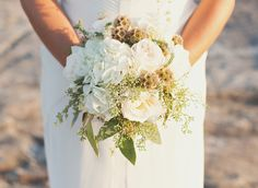 Rustic Wedding Flowers | This bouquet is stunning with its bold blues and greens colors which ...