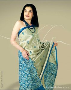 Tussar silk with contrasting turquoise blue pallu and blouse and hand block print on body