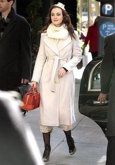In Season 5 Blair Waldorf (Leighton Meester) kept warm wearing a Diane von Furstenberg coat, an Ann-Marie Faulkner fascinator and a Loewe handbag.