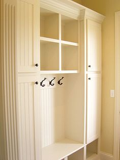 Foyer storage. You don't have this much space but we could fit something similar to the middle section with a storage drawer underneath