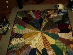 tie quilt. My mother made one back in 1978 out of silk ties she found in my dads men's store. Hers was a crazy quilt she also hand embroidered. This one is beautiful too.