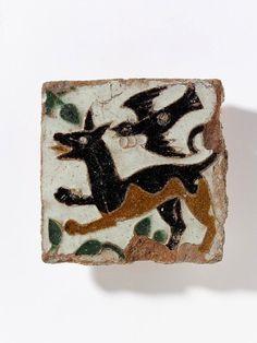 Tile, tin-glazed earthenware, olambrilla, made in Toledo, Spain, ca. 1475-1500 (via Victoria & Albert Museum)