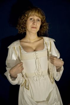 Baroque Underbodice        The typical highwaisted underbodice consists of two parts – the underbodice itself and the stomacher (can be seen on the previous picture), a triangular part of a garment boned by barked reed which covers lacing of the underbodice. The fastening of the underbodice is made according to a drawing of an extant boned bodice pattern located in Museum of London dated back to circa 1635. The separate flat collar and separate cuffs (see J. Arnold: Patterns of Fashion 4) bo...