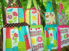 Child-sized aprons made from $1 store potholders and coordinating dish towels. I washed and dried them, pressed them and cut the towels in half...so you get 2 skirt parts in one towel. Bib and skirt are sewn onto wide grosgrain ribbon to form the waistband and also make a ribbon neck loop. These were sewed on the machine but could be hand-sewn if you prefer. I made these four in just a couple of hours :)