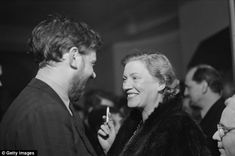 1950. Lee Miller (right) with art critic Frederick Laws (left) at a theatre performance in 1950. In her later years Miller suffered from depression