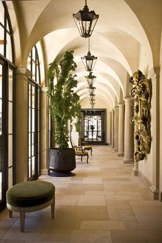 Love the groin Vaulted ceiling the arched doorway and the columns. The lighting adds a beautiful visual rhythm to this elegant space.