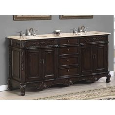 Add functional elegance to your bathroom with this luxurious traditional double vanity. This double basin sink sits in a beautiful white marble top. An elegant and intricate cabinet base has a brown cherry finish and provides plenty of storage.