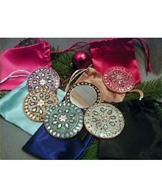 @Overstock - Set yourself apart from the crowd with this intricately detailed hand mirror from India. These purse mirrors are perfect for a quick lipstick check, and compact enough to fit in a purse or pocket, they make an excellent gift for all occasions.http://www.overstock.com/Worldstock-Fair-Trade/Set-of-6-Purse-Mirrors-with-Satin-Pouches-India/572540/product.html?CID=214117 $24.49