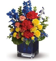 An artist's palette of color spontaneously bursts forth in this array of favorite flowers in a blue contemporary glass cube vase. Van Gogh, Renoir, Pollock - send this floral masterpiece to a colorful friend. Rose Delivery, Flower Delivery, Summer Flowers, Yellow Flowers, Blue Flower Arrangements, Blue Delphinium, Red Carnation, Blue Food Coloring, Color Collage