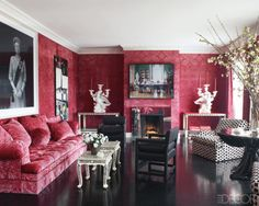 From Elle decor. Using photography in a rather traditional room. One reason I think this works is that there is basically just one color, fuscia, in the room. everything else is neutral and mostly patternless.