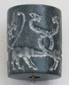 Jasper cylinder seal, Sumeria 3000-4100 B.C., Louvre. Mesopotamian cylinder seals are small cylinders, generally made of stone and pierced through from end to end so that they could be worn on a string or pin. The surface of the cylinder was carved with a design, so that when rolled on clay the cylinder would leave a continuous impression of the design, reversed and in relief.