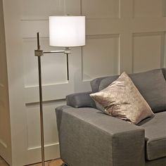 We think our Topanga Floor Lamp by Jamie Drake looks beautiful next to this luxe couch. On location at the A. Rudin San Francisco showroom.