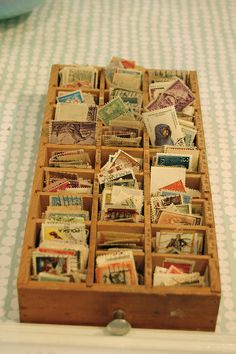 Put an old stamp collection into a printer's tray for display. You could also display buttons or other tiny items this way. Use a larger drawer/tray for larger items.