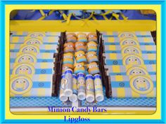 Minion favors... Chocolate Hershey's and lip gloss...thanks to free printables to Halegrafx ...