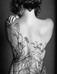 Back tattoo If I could make this resemble the reeds by the lake up north I would get this