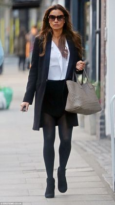 A leggy display: Melanie Sykes caught the eye during an appearance in Hampstead on Friday . Melanie Sykes, That Look, Friday, Display, Legs, Chic, Fashion, Floor Space, Shabby Chic