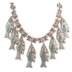 Antique Mexican  Sterling, Turquoise and Coral Repousse Necklace,  Mexico,1930's, is the design of Matilde Poulat but executed by the Barreto Taller in Mexico City. The original fish necklaces originate from the State of Michoacan in the lakes area of Patzcuaro.