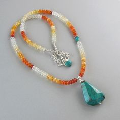 Mexican Fire Opal Chrysocolla Necklace Nugget Turquoise Sterling Silver Bead DJStrang Boho Chic Blue Green Orange White by DJStrang on Etsy https://www.etsy.com/listing/191915834/mexican-fire-opal-chrysocolla-necklace
