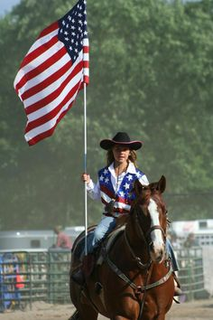 A cowgirl at the rodeo - proud of her country!