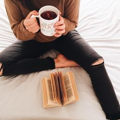 """1,996 Likes, 34 Comments - t h e b i b l i o t h e q u e (@thebibliotheque) on Instagram: """"This is me in my natural habitat. My bed, my brew, my book, my ripped jeans. . And my new profile…"""""""