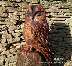 A Tawny owl carved from oak