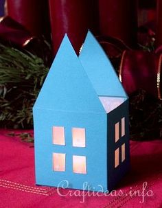 Make something like this out of wood for votive candles. ---> Christmas Paper Craft - How to Make a Paper House Mini Table Lantern Cool Paper Crafts, Christmas Paper Crafts, Christmas Ornaments, Tea Light Lanterns, Tea Lights, All Things Christmas, Christmas Time, Christmas Ideas, Craft Projects