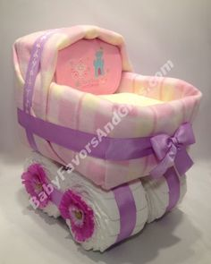 Pink for girl - Baby carriage diaper cake - Unique baby shower gifts from BabyFavorsAndGifts.com/diaper-cakes-c-3.html