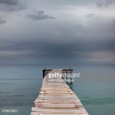 Seascape with dock with storm in the background