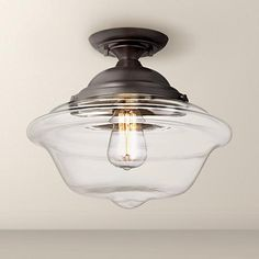 "Is this the one you want to use? I'm keeping the other one on the board until I know for sure. Possini Euro Schoolhouse 13"" Wide Bronze Ceiling Light"