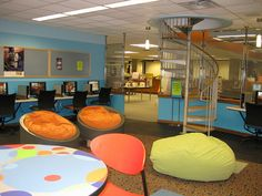 "Oh MY!  New 2-floor teen center with ""study"" area on the main floor and a spiral staircase to the ""recreation"" space on the second floor. The second level was once a library storage room.  Mead Public Library, WI. Photo by Kimberly Bolan Cullin, via Flickr"
