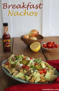 Breakfast nachos - with tofu scramble, refried beans, and cashew queso #vegan #vegetarian #glutenfree