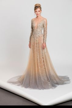 Long sleeves evening dress in nude and silver shades featuring embroidered sequins, crystals and pearls.