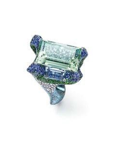 Wallace Chan Cloudless Climes ring set with a central 31.13ct aquamarine and two additional aquamarines, diamonds, tsavorites, garnets and s...