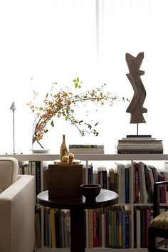 Collections in Modern Rooms  A Square One Riviera chair and Champagne end table;  lamp by Philippe Starck; sculpture by David Brothers;  Johnson and Hill have hundreds of art and architecture books  which they use constantly for reference.