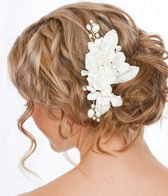 curly updo. stunning with the flower piece and pieces hanging in front