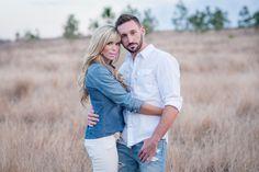 Beautiful couple in a field Photo By Eternal Light Photography