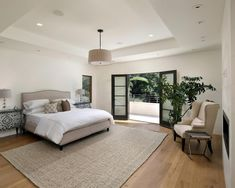 Master bedroom features a neutral palette offering a soft relaxing