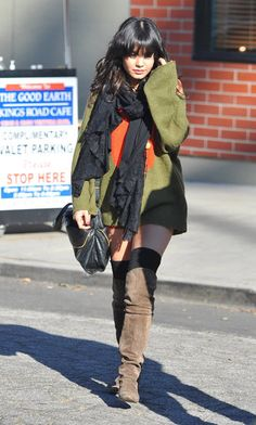 Cute Winter Scarves: Vanessa Hudgens paired a chic ruffled black scarf with knee-high boots and an autumnal color palette.
