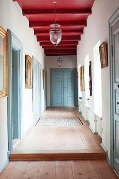 Highlight - These Painted Ceilings Are Giving Us Life - Photos // red ceilings, blue doors, wooden floors