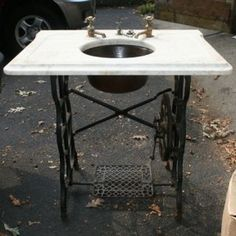 Sewing machine sink stand I think this would look great outside ... family bbq's .. everyone needs to wash their hands!