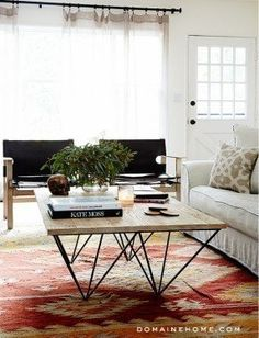 Love the rustic modern coffee table in Benji Madden's home