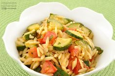 Orzo is flavored with onion and garlic, simmered in chicken broth until tender and combined with fresh zucchini and tomatoes for an easy side dish.