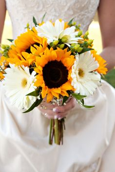 Larger bloomed focal flowers such as bright yellow Sunflowers and white Gerbera Daisies look beautiful grouped together, as shown here. Baby's Breath and Hypericum fill in to finish this stunning bouquet. Shop Sunflowers, Gerbera Daisies, Baby's Breath, and Hypericum year-round at GrowersBox.com!