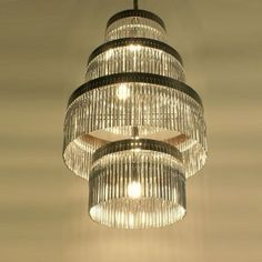 I am looking for the parts of this chandelier to make one with other upcycled items. Does anyone know where I can get the lamp parts? I can't find the metal rings. I'd also like it to be prewired.