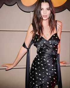 Emrata wearing a Markarian dress at the Moschino party during Coachella