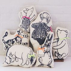 Winnie the Pooh screen printed pillows << OMG, I need them all.